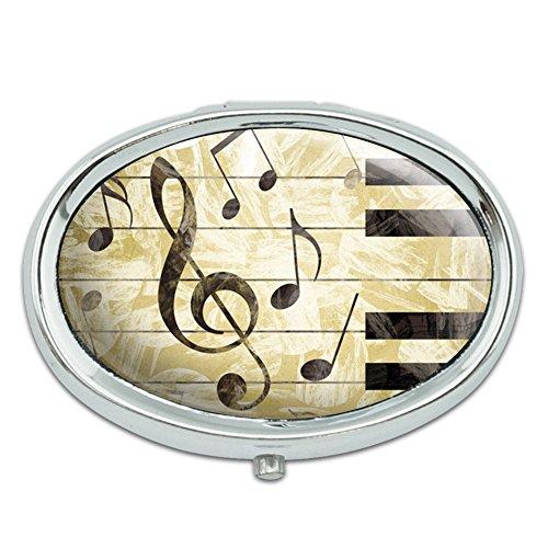 Vintage Piano con clave de sol y notas musicales Metal Oval caso pastillero