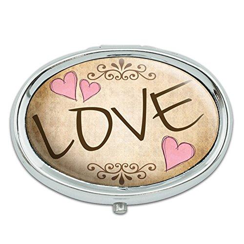 Amor con corazones Vintage Metal Oval caso pastillero